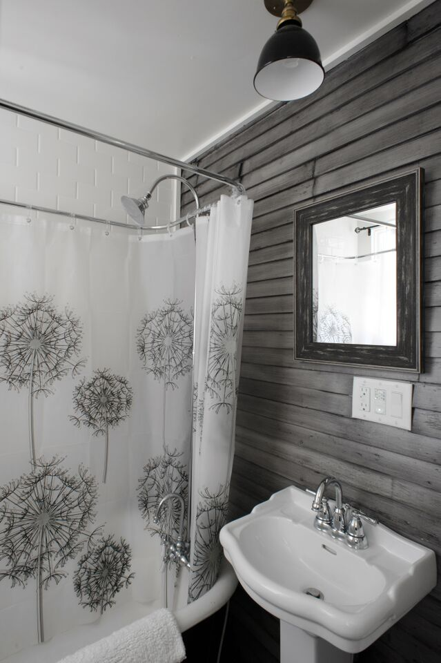 vintage bath grey wood paneling clawfoot tub